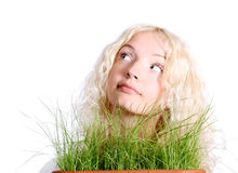 Young woman with grass Stock Image
