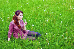 Young woman on grass royalty free stock photo
