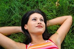 Woman in park. Young woman on the grass Royalty Free Stock Photography