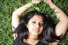 Young woman on grass Royalty Free Stock Photos