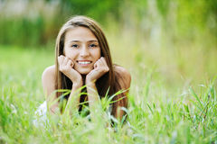 Young woman grass lying Stock Images