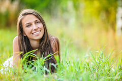 Young woman grass lying Royalty Free Stock Images