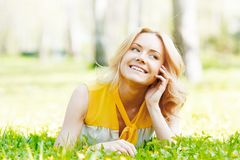 Young woman on grass Stock Photo