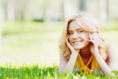 Young woman on grass Stock Photography