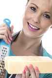 Young Woman Grating Cheese Royalty Free Stock Images