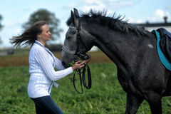 Young woman with a gray horse Stock Images