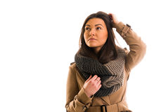 Young woman with a gray scarf is looking straight ahead Stock Photography