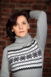 Young woman in a gray sweater Stock Photography
