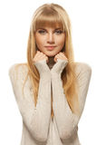 Young woman in gray sweater and jeans Stock Images