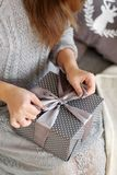 Young woman opens the box with a Christmas present royalty free stock photo