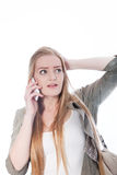 Young Woman in Gray and White Talking on Phone Stock Image