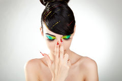 Young woman with great colorful makeup Stock Photos