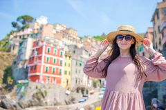 Young woman with great view at old village Riomaggiore, Cinque Terre, Liguria Royalty Free Stock Photos