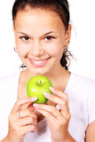 Young woman with green apple. Young woman holding a green apple on white background Royalty Free Stock Photo