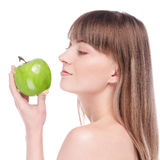 Young woman with green apple Royalty Free Stock Image