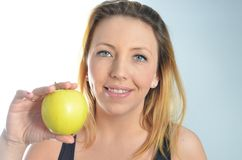 Young woman with green apple Stock Images