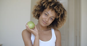 Young Woman With Green Apple In Hands Royalty Free Stock Photo