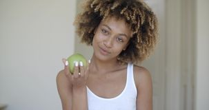 Young Woman With Green Apple In Hands stock video