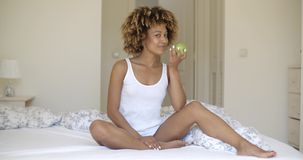 Young Woman With Green Apple In Hands stock footage