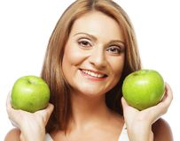 Young woman with green apple Royalty Free Stock Photography
