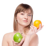 Young woman with green apple and orange Royalty Free Stock Photos