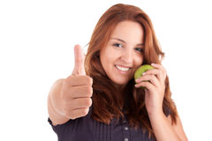 Young woman with green apple and showing thumb up Royalty Free Stock Image