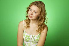 Young woman on green background Stock Photo