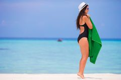 Young woman with green beach towel during tropical Stock Photo