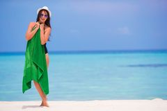 Young woman with green beach towel during tropical Royalty Free Stock Image