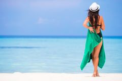 Young woman with green beach towel during tropical Stock Photography