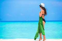 Young woman with green beach towel during tropical Stock Images