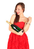Young woman with green bottle of champagne Stock Photography