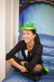 Young woman in a green cap on birthday Stock Photos