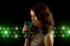 Young woman with a green cocktail Stock Photography
