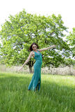 Young woman in green dress Stock Photo