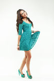 Young woman in a green dress with curly long hair Royalty Free Stock Images