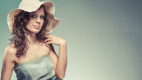 Young woman with green dress and hat. Royalty Free Stock Images