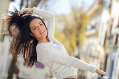 Young woman with green eyes, moving her hair Royalty Free Stock Photos