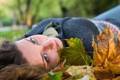 Young woman with green eyes in the park Stock Image