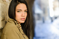 Young woman with green eyes in urban background Stock Photos