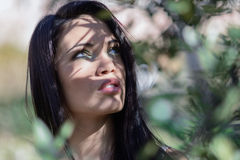 Young woman with green eyes in urban park Stock Photography