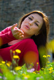 Young woman on green field Royalty Free Stock Image