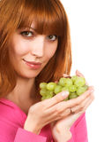 Young woman with green grape Royalty Free Stock Image