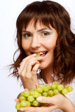 young woman with green grapes Royalty Free Stock Photo