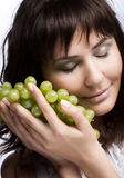 Young woman with green grapes Royalty Free Stock Image