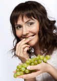 Young woman with green grapes Stock Photography