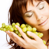 young woman with green grapes Royalty Free Stock Photography