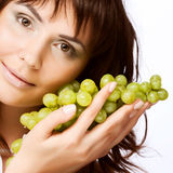 Young woman with green grapes Royalty Free Stock Photos