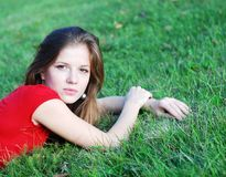 Young woman and green grass Royalty Free Stock Photography
