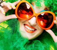 Young  woman with green hair and carnaval glasses Stock Photos